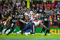 3rd November 2019; Wembley Stadium, London, England; National Football League, Houston Texans versus Jacksonville Jaguars; Running Back Ryquell Armstead of Jacksonville Jaguars is tackled by Linebacker Peter Kalambayi of Houston Texans - Editorial Use