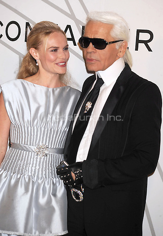 Karl Lagerfeld and Kate Bosworth at the opening night party for Mobile Art: Chanel Contemporary Art Container by Zaha Hadid. Rumsey Playfield in Central Park. New York City. October 21, 2008. Credit: Dennis Van Tine/MediaPunch