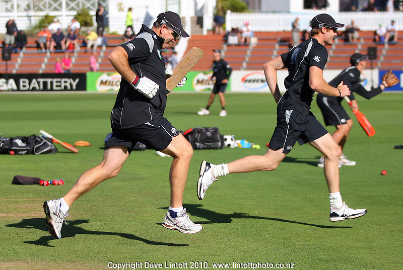 NZ batting coach Mark Greatbatch races Martin Guptill across the field during warm-up during day two of the 1st cricket test match between the New Zealand Black Caps v Australia, day two at the Basin Reserve, Wellington, New Zealand on Saturday, 20 March 2010. Photo: Dave Lintott / lintottphoto.co.nz