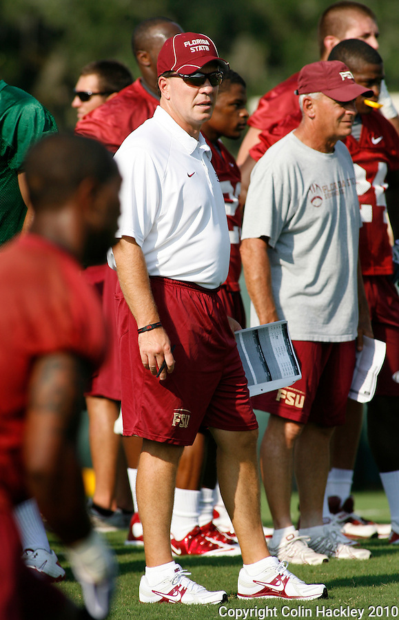 TALLAHASSEE, FL 8/5/10 FSU 080510 CH-Florida State Head Coach Jimbo Fisher, left, and Offensive Line Coach Rick Trickett watch the team during the first day of practice Thursday in Tallahassee. .COLIN HACKLEY PHOTO