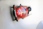 15 December 2007: USA 1 pilot Steve Holcomb with brakeman Curtis Tomasevicz exit a turn during their first run at the FIBT World Cup Bobsled Competition at the Olympic Sports Complex on Mount Van Hoevenberg, at Lake Placid, New York, USA. USA 1 came in third to take the Bronze Medal...Mandatory Photo Credit: Ed Wolfstein Photo