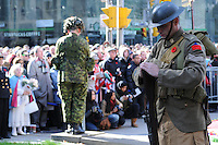 Two silent sentries on solemn guard amidst Torontonians during the Rememberance Day ceremony at Old City Hall in Toronto, Ontario, Canada, November 11, 2011.