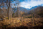 Abandoned swing beneath a mountain, France