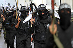 Members of al-Mujahideen brigades, the military wing of al-Mujahideen movement, march during a rally to mark the 14th anniversary of their movement's founding, in Gaza city on April 24, 2015. Photo by Mohammed Asad
