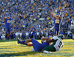 BROOKINGS, SD - SEPTEMBER 6:  Jason Schneider #83 from South Dakota State University hauls in a touchdown pass while being covered by Karlton Dennis #9 from Cal Poly in the first half of their game Saturday evening at Coughlin Alumni Stadium in Brookings. Jackrabbit teammates Dallas Goedert #86 and Trevor Wesley #80 celebrate the touchdown. (Photo/Dave Eggen/Inertia)