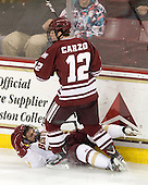 Steven Whitney (BC - 21), Rocco Carzo (UMass - 12) - The Boston College Eagles defeated the University of Massachusetts-Amherst Minutemen 3-2 to take their Hockey East Quarterfinal matchup in two games on Saturday, March 10, 2012, at Kelley Rink in Conte Forum in Chestnut Hill, Massachusetts.