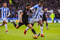 Crystal Palace's midfielder Andros Townsend (10) takes on Huddersfield Town's defender Mathias Jorgensen (25) during the EPL - Premier League match between Huddersfield Town and Crystal Palace at the John Smith's Stadium, Huddersfield, England on 17 March 2018. Photo by Stephen Buckley / PRiME Media Images.