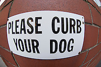"A ""Please curb your dog"" sign seen posted on a building in the New York neighborhood of Chelsea on Monday, May 28, 2012. (©Frances M. Roberts)"