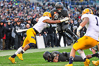 Baltimore, MD - DEC 10, 2016: Army Black Knights running back Kell Walker (32) jumps over his fallen blocker on his way to a first down during game between Army and Navy at M&T Bank Stadium, Baltimore, MD. (Photo by Phil Peters/Media Images International)
