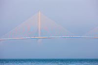 The Sunshine Skyway Bridge, spanning Tampa Bay south of St. Petersburg, Florida, partially hidden by fog.