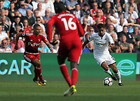 Kyle Naughton of Swansea City (R) in action during the Premier League match between Swansea City and Watford at The Liberty Stadium, Swansea, Wales, UK. Saturday 23 September 2017