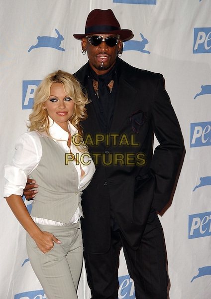 PAMELA ANDERSON & DENNIS RODMAN.Peta's 25th Anniversary Gala and Humanitarian Awards Show held at Paramount Pictures' Studios in Hollywood,California onn .September 10th, 2005.half length hat sunglasses shades black suit jacket grey gray vest arm around waist.www.capitalpictures.com.sales@capitalpictures.com.Supplied By Capital PIctures