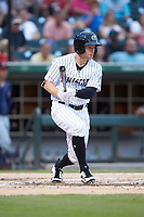 Alex Presley (5) of the Charlotte Knights follows through on his swing against the Toledo Mud Hens at BB&T BallPark on June 22, 2018 in Charlotte, North Carolina. The Mud Hens defeated the Knights 4-0.  (Brian Westerholt/Four Seam Images)