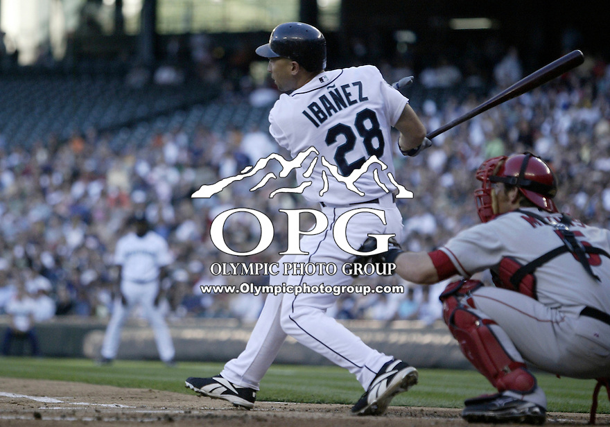 01 August 2007:   Seattle Mariners left fielder Raul Ibanez connects for a base hit against the Los Angeles Angels at Safeco Field. Seattle won 8-7 in 12 innings.