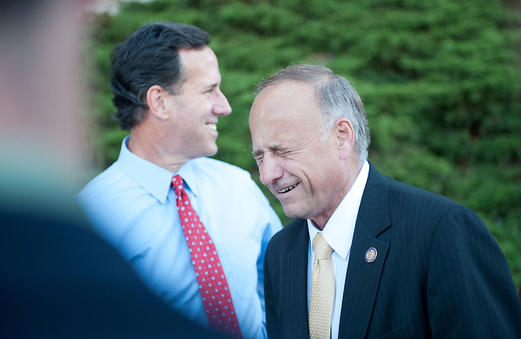 UNITED STATES - AUGUST 11:  Rep. Steve King, R-Iowa, right, and former Senator Rick Santorum, talk with Santourm's family outside of Stephens Auditorium at Iowa State University before the Republican presidential debate in Ames, Iowa.  The debate will feature eight republican candidates including Santorum.   (Photo By Tom Williams/Roll Call)