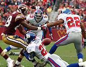 Landover, MD - December8, 2002 --  New York Giant safety Omar Stoutmire (23) strips the ball from Washington Redskin wide receiver Derrius Thompson (88) after a reception.  Giant cornerback Ralph Brown (22) picked-up the ball and returned it into Redskin territory in Landover, Maryland.  The Giants won the game 27 - 21.<br /> Credit: Ron Sachs / CNP<br /> [NOTE: No New York Metro or other Newspapers within a 75 mile radius of New York City]