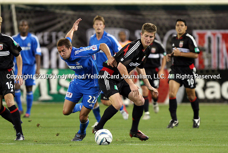 21 May 2005: Davy Arnaud (22) and Bobby Boswell (right) challenge for the ball. DC United defeated the Kansas City Wizards 3-2 at RFK Stadium in Washington, DC in a regular season Major League Soccer game. . .