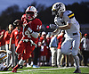 Terrance Edmond #14, Freeport quarterback, gets to within a yard of the end zone during the second quarter of a Nassau County Conference I varsity football game against Massapequa at Freeport High School on Friday, Oct. 5, 2018.
