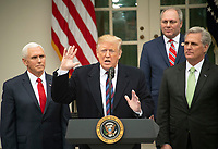 United States President Donald J. Trump makes a statement following his meeting with Democratic leaders in the Situation Room of the White House in Washington, DC in an effort to break the political impasse on border security and reopen the federal government on Friday, January 4, 2018.  The President also took questions from reporters.  Looking on, from left to right, are: US Vice President Mike Pence, US House Minority Whip Steve Scalise (Republican of Louisiana), and US House Minority Leader Kevin McCarthy (Republican of California). Credit: Ron Sachs / CNP/AdMedia