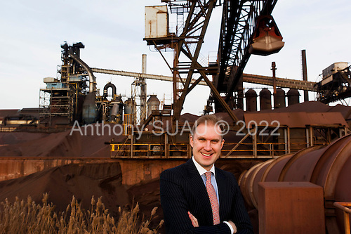 Dearborn, Michigan<br /> USA<br /> February 16, 2011<br /> <br /> Sergei A. Kuznetsov, chief executive officer of Severstal North America in front of the old (left) and new &quot;C&quot; blast furnaces. <br /> <br /> The former Ford Rouge Steel Plant completed in 1928 is now owned, run and being renovated and expanded by Russian owner &quot;Severstal North America&quot;. This is one of five steel plants owned by Severstal in the United States and they are spending huge sums to convert it into what could be the continent's most efficient automotive steel plant.<br /> <br /> Rouge Steel fell on hard times after Ford Motor Company spun it off in 1989 into an independent steel company. <br /> <br /> After buying the assets of the bankrupt company for USD 280 million, Severstal spent USD 350 million to repair one of the blast furnaces. The company built a new cold-rolling line which converts steel slabs into sheet metal. And it added a galvanizing line which coats sheet metal with zinc for rust-resistant body panels.<br /> <br /> The operation assets and improvements amount to USD 1.4 billion. Add in spending on a new mini mill in Columbus, Mississippi a USD 1.6 billion operation and Severstal has placed a USD 3 billion bet on North America auto industry.<br /> <br /> Mr Kuznetsov said &quot;The auto industry will have to meet tough fuel efficiency standards and weight is a big issue. Vehicles have to be lighter and I think this is going to be a big play for the industry.&quot;