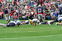 August 2, 2017: New England Patriots wide receiver Julian Edelman (11) (yellow shirt) and members of the Patriots offensive line do pushups at the New England Patriots training camp held at Gillette Stadium, in Foxborough, Massachusetts. Eric Canha/CSM