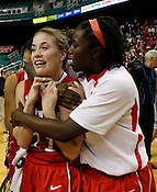 Emili Tasler celebrates the Wolfpack victory. NC State defeated Duke 75-73 during quarter finals of the 2012 ACC Women's Basketball Tournament at the Greensboro Coliseum in Greensboro, NC. Photo by Al Drago.