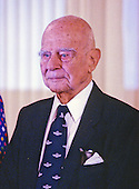 United States Air Force General Jimmy Doolittle is pictured during the ceremony where he is awarded the Presidential Medal of Freedom, the highest civilian award of the US, by US President George H.W. Bush and first lady Barbara Bush in the East Room of the White House in Washington, DC on July 6, 1989.  Doolittle was known for his development of instrument flying and for leading a 1942 air raid on Tokyo, Japan, for which he received the Medal of Honor.<br /> Credit: Ron Sachs / CNP