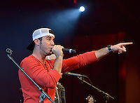 NWA Democrat-Gazette/BEN GOFF -- 04/26/15 Vocalist Craig Strickland performs as the Fayetteville band Backroad Anthem plays a set at the FLW Expo on the final day of the Walmart FLW Tour at Beaver Lake at the John Q. Hammons Center in Rogers on Sunday Apr. 26, 2015.