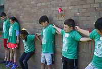 NWA Democrat-Gazette/CHARLIE KAIJO Students cool off by becoming the targets for water balloons after applying a lesson on kinetic and potential energy during a STEM summer camp, Monday, June 10, 2019 at Bonnie Grimes Elementary School in Rogers.<br />