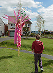 Stilt walkers: Sara and Emma-Lou as 'Birds of Paradise' from Vertigo Stilts at the official opening of the site  <br /> <br /> Redrow Homes Official opening of  at Belle View at Mon Bank Newport with Cardiff Blues Players Alex Cuthbert and Rhys Williams - Newport <br /> <br /> &copy; www.sportingwales.com- PLEASE CREDIT IAN COOK