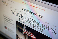 The Boston Globe website on Friday, April 19, 2013 reports on the capture of 19 year-old Dzhokhar Tsarnaev and the shooting of his brother 26 year-old Tamerlan Tsarnaev, the alleged Islamic terrorists in the bombing at the finish line of the Boston Marathon on April 15. The newspaper suspended its paywall for the news allowing non-subscribers to read the stories.(© Richard B. Levine)
