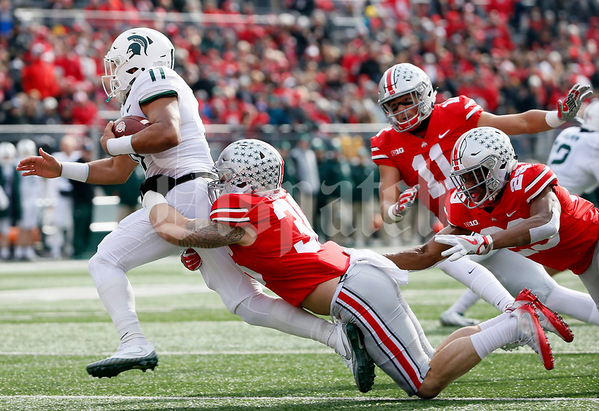 Michigan State Spartans running back Connor Heyward (11) is tackled by Ohio State Buckeyes linebacker Zach Turnure (36) during Saturday's NCAA Division I football game at Ohio Stadium in Columbus on November 11, 2017. [Barbara J. Perenic/Dispatch]