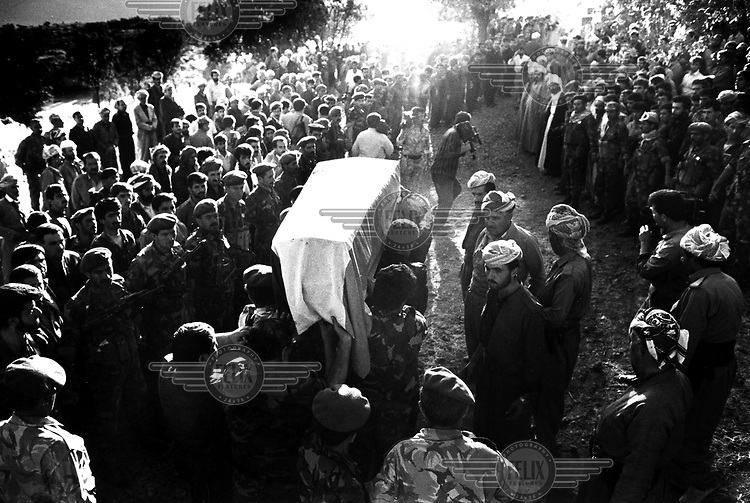 BARZAN, KURDISTAN, IRAQ, OCTOBER 1993.  Kurdish people bring their last salute to their great leader mullah Mustafa Barzani. Barzani was the leader of the KDP in the 70's and died in exile in Iran. ©Photo by Frits Meyst/Panos Pictures