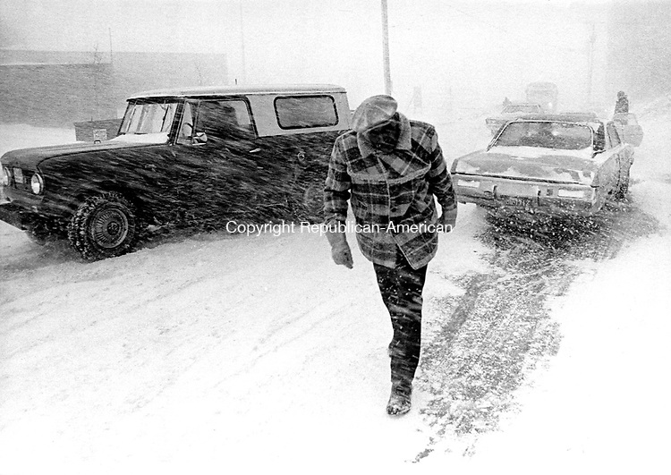 February 6, 1978: BLIZZARD OF '78-  An unknown man makes his way in downtown Waterbury.  Tom Kabelka Photo