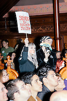 "Kitty Zen, 26, and Nemo Zen, 33, (with bandana) of Cambridge, protested throughout the campaign rally for Green Party presidential nominee Jill Stein at Old South Church in Boston, Massachusetts, on Sun., Oct. 30, 2016. Kitty Zen had a piece of tape over her mouth reading ""classism"" and held a sign reading, on one side, ""Silenced by Boston for Jill Stein."" She said she has been a Green Party member since before Jill Stein was running for president. She said, ""The way her campaign is operating...they don't care about the voices in the community."" She accused the Stein campaign of ignoring local Green Party members, instead favoring the involvement of people who had Democratic National Committee experience, especially on the Bernie Sanders Campaign."