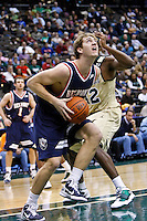 February 03, 2011:   Belmont Bruins forward/center Mick Hedgepeth (34) drives to the basket during Atlantic Sun Conference action between the Jacksonville Dolphins and the Belmont Bruins at Veterans Memorial Arena in Jacksonville, Florida.  Belmont defeated Jacksonville 76-70.