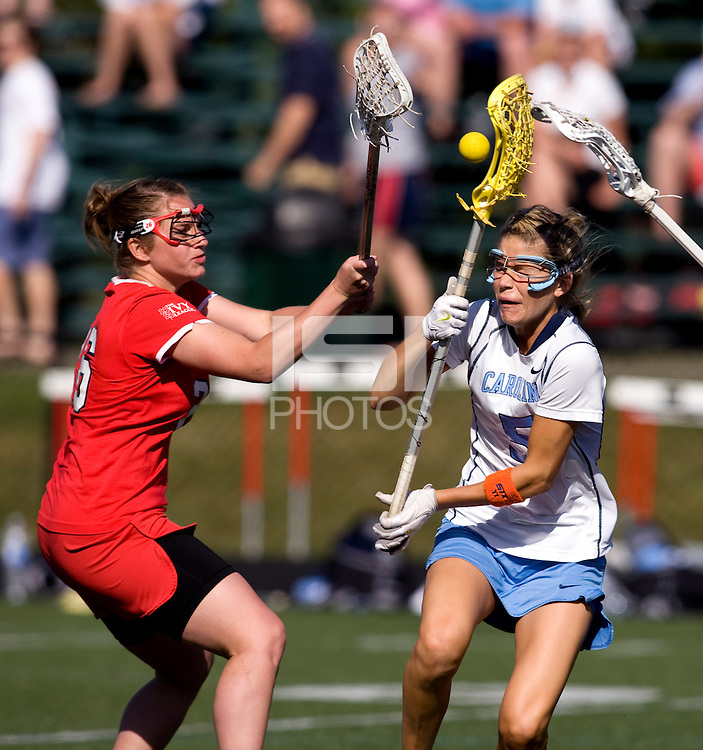 Kristen Taylor (5) of North Carolina is fouled near the goal by Lindsey Kane (26) of Cornell at St. Stephens and St. Agnes High School in Alexandria, VA.  North Carolina defeated Cornell, 13-7.
