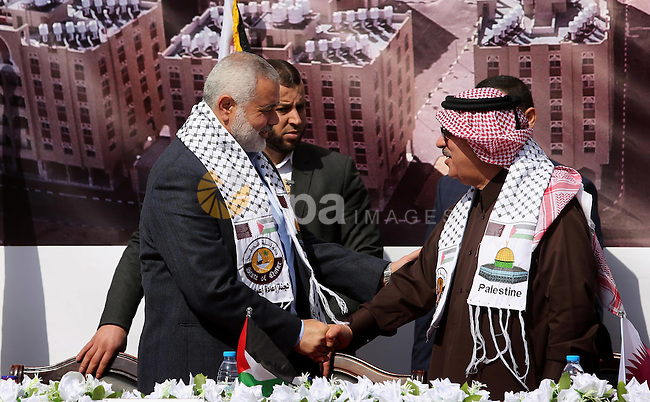 Hamas leader Ismail Haniyeh shakes hands with Qatar's Ambassador to the Palestinian Authority, Mohammed Al Emadi during the ceremony of the second phase of the Sheikh Hamad Town, in Khan Younis in the southern Gaza strip, on February 11, 2017. Photo by Ashraf Amra