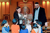 Rabbis Lauren Holtzblatt and Aaron Alexander talk with preschoolers about lighting the menorah the day before Hanukkah starts at the Adas Israel Congregation on Friday, December 23, 2016 in Washington, DC.<br /> Credit: Edward Le Poulin via CNP