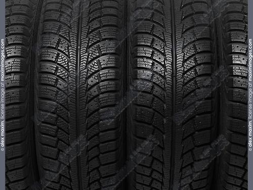 Closeup of a winter car tires background texture
