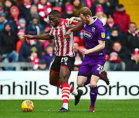 Lincoln City's John Akinde shields the ball from Grimsby Town's Alex Whitmore<br /> <br /> Photographer Andrew Vaughan/CameraSport<br /> <br /> The EFL Sky Bet League Two - Lincoln City v Grimsby Town - Saturday 19 January 2019 - Sincil Bank - Lincoln<br /> <br /> World Copyright © 2019 CameraSport. All rights reserved. 43 Linden Ave. Countesthorpe. Leicester. England. LE8 5PG - Tel: +44 (0) 116 277 4147 - admin@camerasport.com - www.camerasport.com