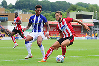 Lincoln City's Jorge Grant shields the ball from Sheffield Wednesday's Liam Palmer<br /> <br /> Photographer Chris Vaughan/CameraSport<br /> <br /> Football Pre-Season Friendly - Lincoln City v Sheffield Wednesday - Saturday July 13th 2019 - Sincil Bank - Lincoln<br /> <br /> World Copyright © 2019 CameraSport. All rights reserved. 43 Linden Ave. Countesthorpe. Leicester. England. LE8 5PG - Tel: +44 (0) 116 277 4147 - admin@camerasport.com - www.camerasport.com
