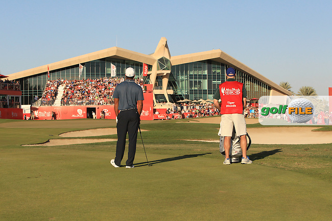 Tiger Woods (USA) and caddy Joe Lacava wait to play his 2nd shot on the 18th hole during Friday's Round 2 of the Abu Dhabi HSBC Golf Championship at Abu Dhabi Golf Club, 18th January 2013 (Photo Eoin Clarke/www.golffile.ie)