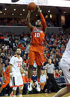 Clemson guard Gabe DeVoe (10) shoots over Virginia guard London Perrantes (32) during an ACC basketball game Tuesday Jan. 19, 2016, in Charlottesville, Va. ( Photo/Andrew Shurtleff)