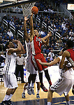 UNLV's Rashad Vaughn (1) shoots past Nevada defenders AJ West (3) and Tyron Criswell (2) during a college basketball game in Reno, Nev., on Tuesday, Jan. 27, 2015. (Las Vegas Review-Journal/Cathleen Allison)