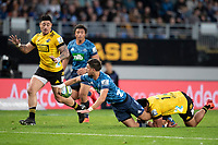 14th June 2020, Aukland, New Zealand;  Blues 1st-five Otere Black lays the ball off in the tackle during the Investec Super Rugby Aotearoa match, between the Blues and Hurricanes held at Eden Park, Auckland, New Zealand.