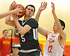 Mike Sixsmith #5 of Holy Trinity tries to maintain possession under defensive pressure during a CHSAA varsity boys basketball game against host Chaminade High School in Mineola on Friday, Feb. 16, 2018. Chaminade won by a score of 79-61.