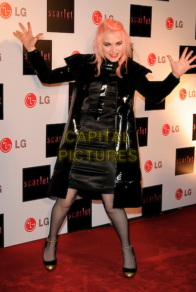 "GUEST & PAM HOGG.Attending the ""Scarlet"" TV Series Launch, No. 1 Marylebone Road, London, England, UK, April 30th 2008..full length black leather shiny pvc coat jacket gold cap tow tone shoes hands arm gesture.CAP/CAN.©Can Nguyen/Capital Pictures"