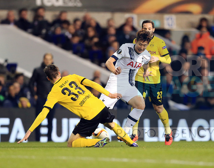 Tottenham's Son Heung-Min tussles with Dortmund's Julian Weigl during the Europa League match at White Hart Lane Stadium.  Photo credit should read: David Klein/Sportimage