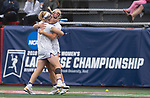 STONY BROOK, NY - MAY 27: Kristen Gaudian #14 of the James Madison Dukes reacts with Annie Dell #15 after scoring a goal during the Division I Women's Lacrosse Championship held at Kenneth P. LaValle Stadium on May 27, 2018 in Stony Brook, New York. (Photo by Ben Solomon/NCAA Photos via Getty Images)